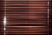Sunlight behind vertical blinds — ストック写真