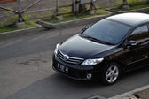 Black colored toyota corolla altis — Stock Photo