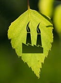 Pollution sign with green leaf — Stock Photo