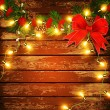 Vector Christmas background with garland on a wooden wall — Stock vektor