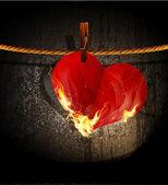 Vektor hořící srdce visí na laně — Stock vektor