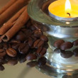 Romantic background with coffee beans, cinnamon and candles — Stock Video