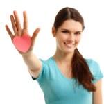 Happy teen girl holding in hand heart love symbol valentine — Stock Photo #21176117