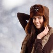 Teennager girl pretty smiling on winter snow winter background — Stock Photo #21484133
