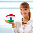 Businesswoman is showing realestate — Stock Photo