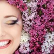 Woman beautiful face with flower lilac frame — Stock Photo