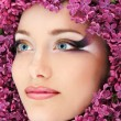 Stock Photo: Woman beautiful face with flower lilac