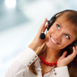 Support phone operator in headset looking up corner at work — Stock Photo #21484853