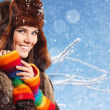 Teennager girl pretty smiling on winter snow blue background — Stock Photo