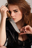 Sexy beautiful woman with knife — Stock Photo