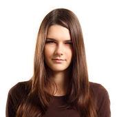 Teen girl makes mistrustful grimace isolated — Stock Photo