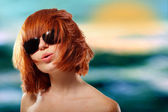 Summer teen girl redhaired cheerful in sunglasses enjoying over — Stock Photo