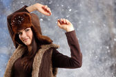 Teennager girl pretty smiling on winter winter background — Stock Photo