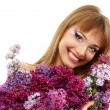 Woman beautiful face with flower lilac — Stock Photo #21707889