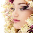 Royalty-Free Stock Photo: Woman beautiful face with flower lilac and chestnut