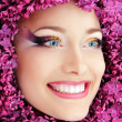 Woman beautiful face with flower lilac — Foto de Stock
