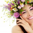 Woman beauty face makeup with summer field wild flowers fresh na — Stock Photo #21708097