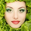 Woman beauty face with green fresh lettuce leaves — Stock Photo