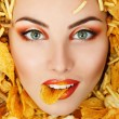 Stock Photo: Wombeauty face with unhealth eating fast food potato chips ru