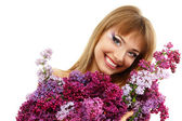 Woman beautiful face with flower lilac — Stock Photo