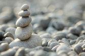 Balanced stones over nature background — Stockfoto