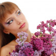 Woman beautiful face with flower lilac — Stock Photo #33512187