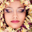 Woman beautiful face with chestnut flower frame — Stok fotoğraf