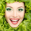 Woman beauty face with green fresh lettuce leaves frame — Stock Photo #33512513