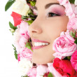 Beauty portrait of beautiful young female face with flower roses — Stock Photo