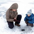 Winter fishing family leisure — Stock Photo