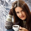 Teen girl attractive drinking coffee over winter nature — Stock Photo