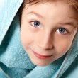 Little boy beautiful after shower with bath towel — Stock Photo #33514377