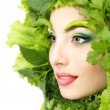 Woman beauty face with green fresh lettuce leaves — Stock Photo #33515529