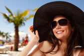 Summer beach teen girl cheerful in panama and sunglasses — Stock Photo