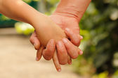 Family father and child son hands nature — Stock Photo