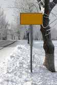 Winter road with traffic sign — Stock Photo
