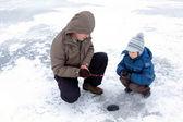Winter fishing family leisure — Stock Photo