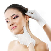 Beautiful young woman face with beauty treatment ear plastic — Stock Photo