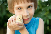Boy cute hugs chiken in hand nature summer outdoor — Stock Photo