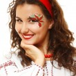 Beautiful ukrainian young woman with artistic makeup like a red flower — Stock Photo