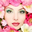 Beautiful female face with pink, red and white mallow flowers frame — Stok fotoğraf