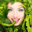 Woman beauty face with greens vegetables and pepper frame — Stock Photo