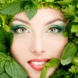 Woman beauty face with greens vegetables frame — Stock Photo