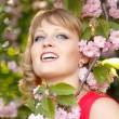 Stock Photo: Beautiful woman enjoying near blooming Japanese cherry tree