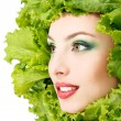 Woman beauty face with green fresh lettuce leaves frame — Stock Photo #33646383
