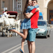 Love story of young couple hug in summer city — Stock Photo