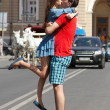 Stock Photo: Love story of young couple hug and kiss in summer city