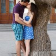 Young couple hug and kiss outdoor — Stock Photo