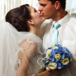 Beautiful young bride kiss groom — Stock Photo