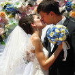 Wedding ceremony - groom kiss bride — Stock Photo